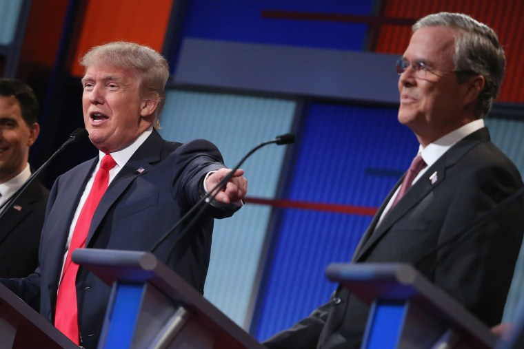 Republican presidential candidates Donald Trump and Jeb Bush participate in the first prime-time presidential debate on Aug. 6, 2015 in Cleveland, Ohio. (Photo by Chip Somodevilla/Getty)