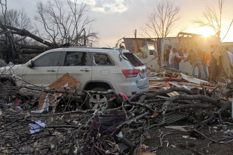 Neighbors help salvage items from a storm-damaged home in the Roundaway community near Clarksdale, Miss., Dec. 23, 2015. (Photo by Troy Catchings/The Press Register/AP)