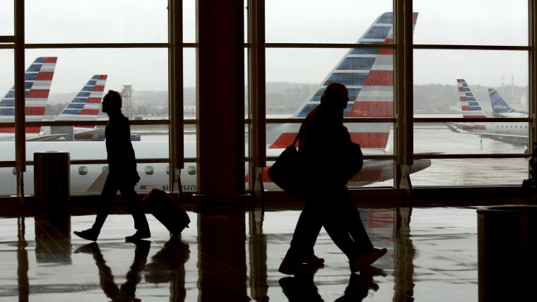 Travelers make their way through Reagan National Airport in Washington, D.C., on Dec. 23, 2015. (Photo by Kevin Lamarque/Reuters)