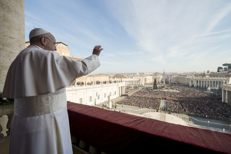 "Pope Francis delivers his ""Urbi et Orbi"" (to the city and to the world) blessing from the central balcony of St. Peter's Basilica at the Vatican, Friday, Dec..."