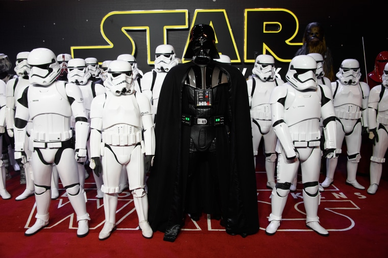 Actors dressed as Stormtroopers and Darth Vader pose for photographers upon arrival at the European premiere of the film 'Star Wars: The Force Awakens ' in London, Dec. 16, 2015. (Photo by Jonathan Short/Invision/AP)