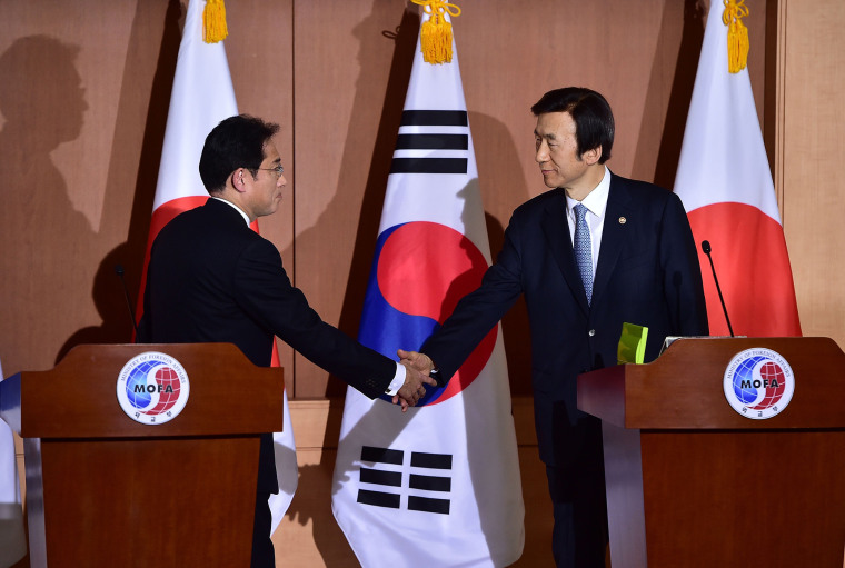 Japan's Foreign Minister Fumio Kishida shakes hands with his South Korean counterpart Yun Byung-Se after a joint press briefing at the Foreign Ministry in Seoul, Dec. 28, 2015. (Photo by Jung Yeon-Je/AFP/Getty)