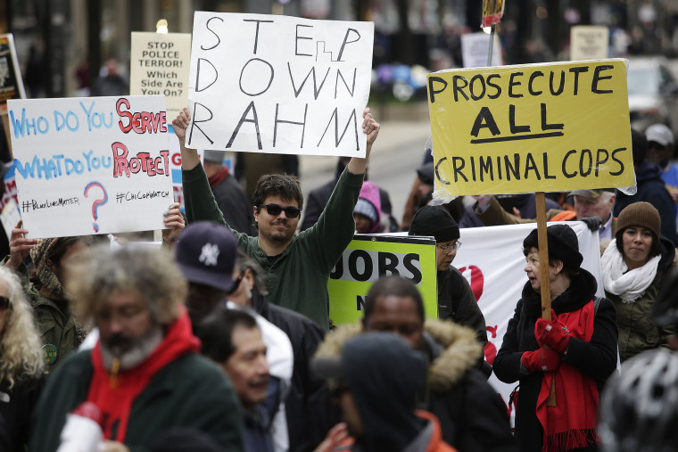Demonstrators continue to protest the fatal police shooting of Laquan McDonald as they attempt to disrupt holiday shoppers along Michigan Avenue Dec. 24, 2015 in Chicago, Ill. (Photo by Joshua Lott/Getty)