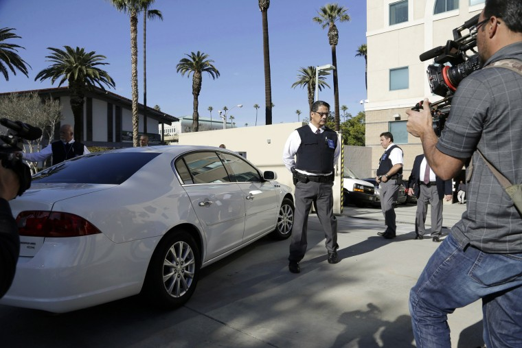 Security is tight as a car carrying Enrique Marquez Jr. arrives at U.S. District Court in Riverside, Calif., Dec. 17, 2015. (Photo by Nick Ut/AP)