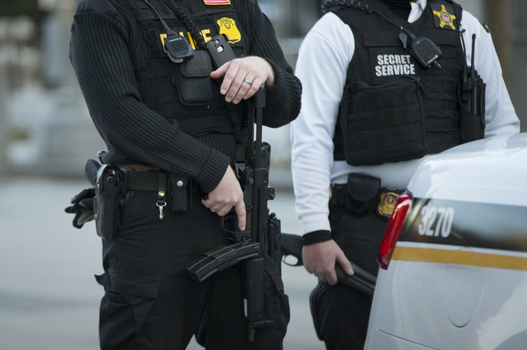 Secret Service police stand guard in Washington, D.C. (Photo by Evan Vucci/AP)