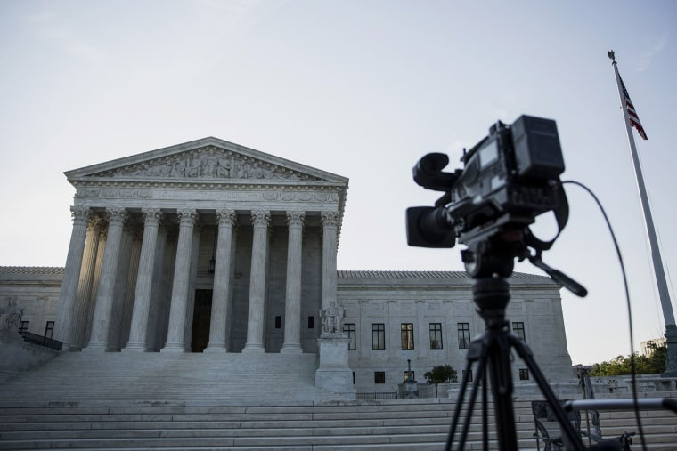 A camera sits on a tripod in front of the U.S. Supreme Court in Washington, D.C. (Drew Angerer/Bloomberg/Getty).