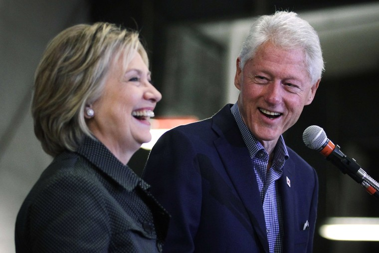Former President Bill Clinton shares a laugh with his wife and Democratic presidential candidate Hillary Clinton during an event, Nov. 15, 2015 in Ames, Iowa. (Photo by Alex Wong/Getty)