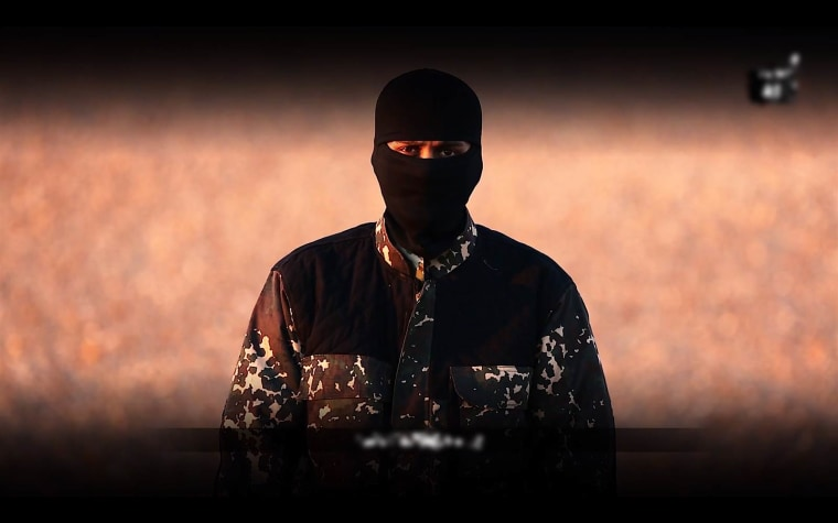A screengrab of the ISIS propaganda video featuring a masked man with what sounded like a British accent. (Photo by Flashpoint)