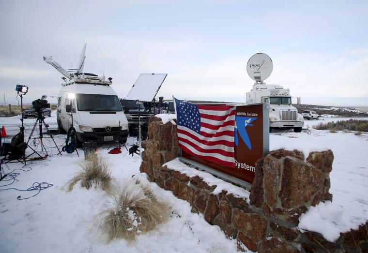 Media and satellite trucks are seen at the Malheur National Wildlife Refuge near Burns, Ore., Jan. 4, 2016. (Photo by Jim Urquhart/Reuters)