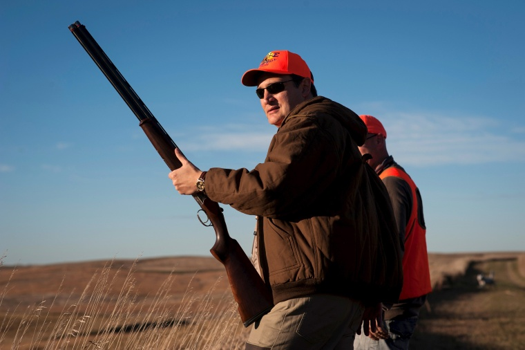U.S. Republican presidential candidate Sen. Ted Cruz pauses before heading further down field during the Col. Bud Day Pheasant Hunt hosted by Congressman Steve King outside of Akron, Ia., Oct. 31, 2015. (Photo by Mark Kauzlarich/Reuters)