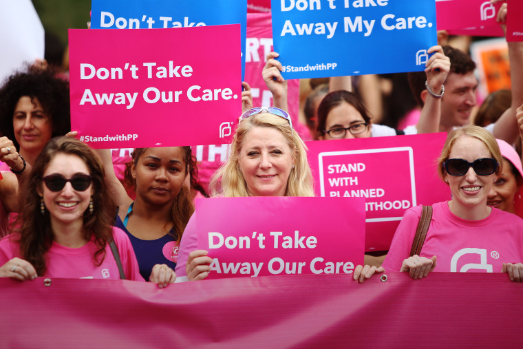 Pro-choice protesters hold pink Planned Parenthood banner and signs in Foley Square, New York, Sept. 29, 2015. (Photo by Andy Katz/Pacific Press/ZUMA)