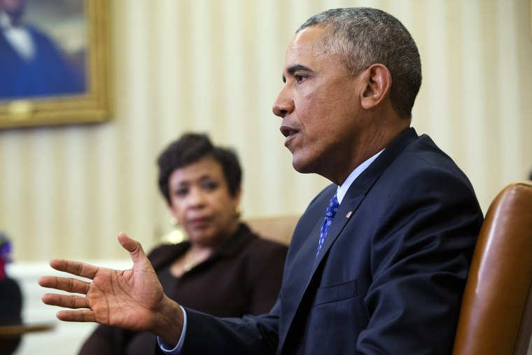 Attorney General Loretta Lynch listens as President Barack Obama speaks in the Oval Office of the White House in Washington, Jan. 4, 2016. (Photo by Pablo Martinez Monsivais/AP)