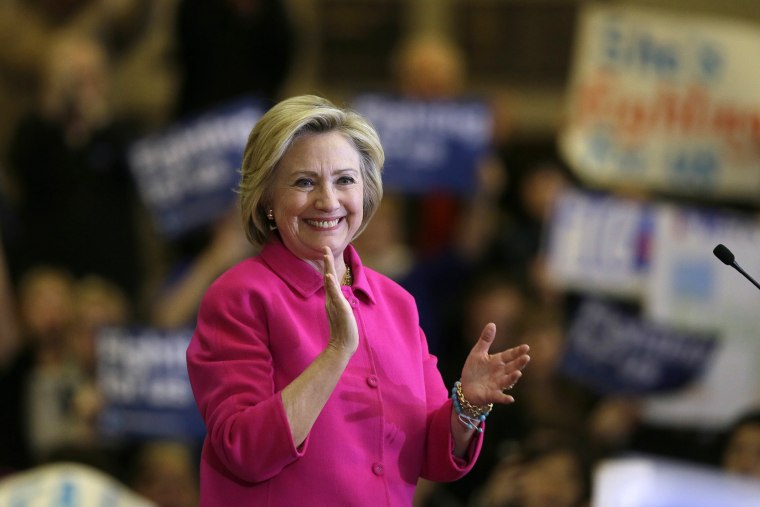 Democratic presidential candidate Hillary Clinton reacts to supporters after speaking at a campaign rally at the Iowa State Historical Museum, Jan. 4, 2016, in Des Moines, Iowa. (Photo by Charlie Neibergall/AP)