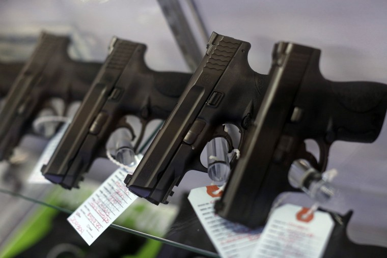 Handguns are seen for sale in a display case in Bridgeton, Mo. (Photo by Jim Young/Reuters)