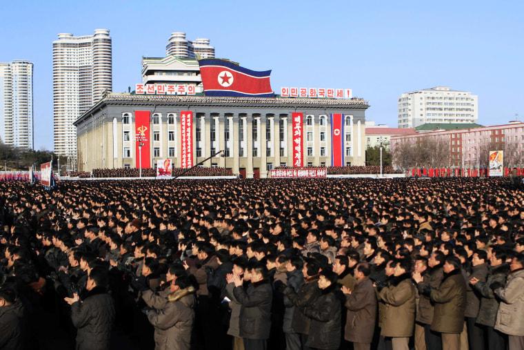 North Koreans gather at Kim Il Sung Square, following their leader Kim Jong Un's new year address in Pyongyang, North Korea, Jan. 5, 2016. (Photo by Jon Chol Jin/AP)