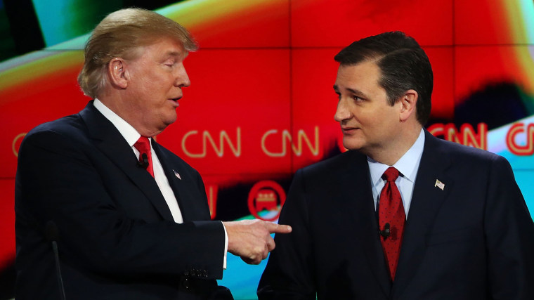 Republican presidential candidates Donald Trump and Sen. Ted Cruz, interact at the conclusion of the CNN republican presidential debate at The Venetian Las Vegas on Dec. 15, 2015 in Las Vegas, Nev. (Photo by Justin Sullivan/Getty)