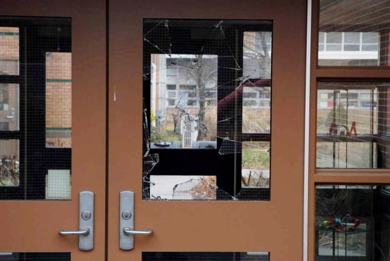 This handout crime scene evidence photo provided by the Connecticut State Police shows a damaged door of the Sandy Hook Elementary School following the Dec. 14, 2012 shooting rampage. (Photo by Connecticut State Police/Getty)