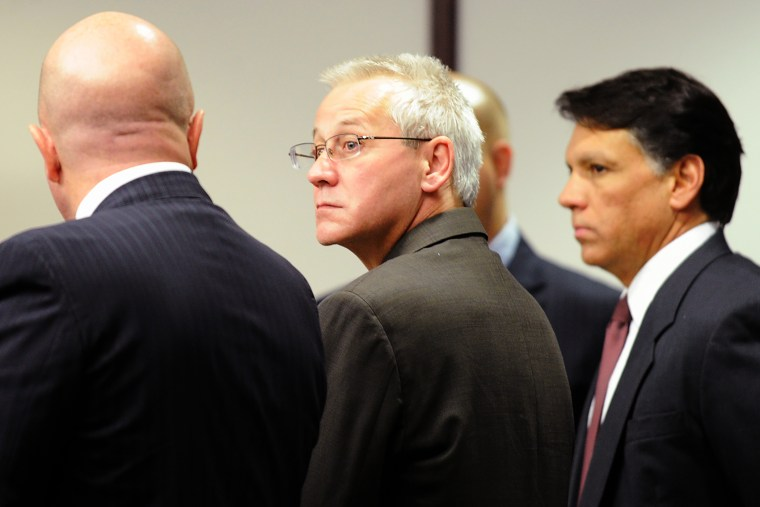 In this Thursday, April 19, 2012, file photo, Oscar Ray Bolin Jr. watches as jurors walk into the courtroom in Tampa, Fla. (Photo by Chris Urso/The Tampa Tribune/AP)