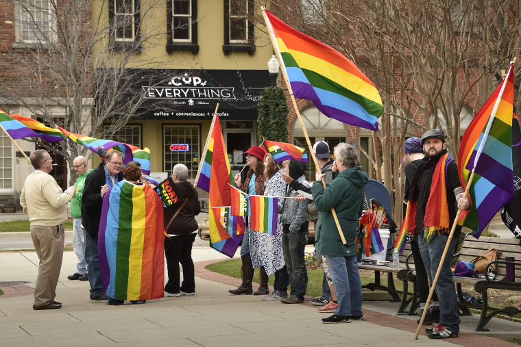 A group of same-sex marriage activists gathered outside the Madison County Courthouse to protest Judge Roy Moore's statements, Jan. 6, 2016, Ala. (Photo by Bob Gathany/AL.com/Landov)