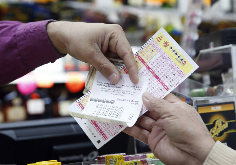 Money and Powerball tickets change hands at Pine Liquors in Fort Washington, Md., Jan. 8, 2016, for the upcoming Powerball drawing. (Photo by Alex Brandon/AP)