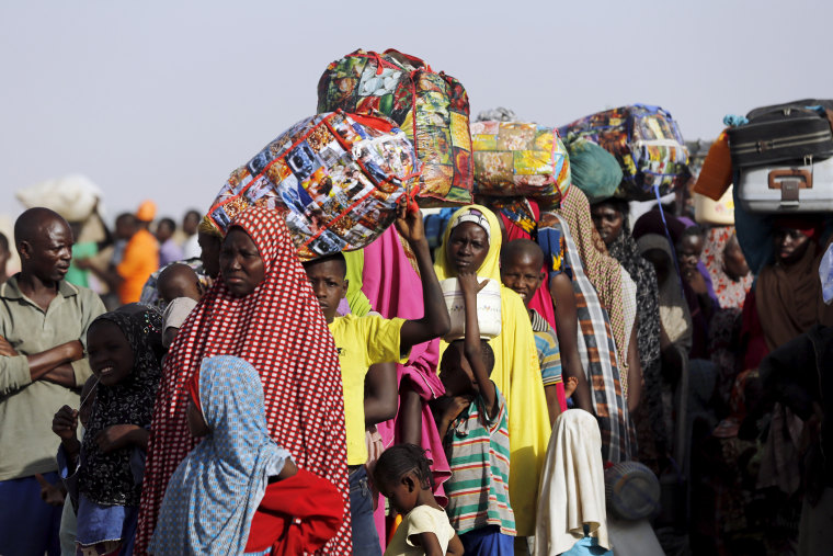 Returnees queue during the evacuation of Nigerians displaced by Boko Haram militants, at a camp for displaced people in Geidam, Yobe state, Nigeria, May 6, 2015. (Photo by Afolabi Sotunde/Reuters)