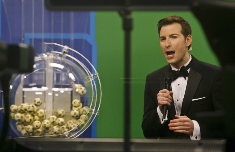 Host Sam Arlen speaks as the winning Powerball numbers are about to be drawn at the Florida Lottery studio in Tallahassee, Fl., Jan. 9, 2016. (Photo by Philip Sears/Reuters)