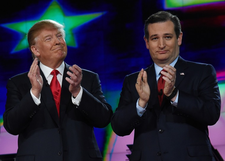 Republican presidential candidates Donald Trump and Sen. Ted Cruz (R-TX) applaud as they are introduced during the CNN presidential debate at The Venetian Las Vegas on Dec. 15, 2015 in Las Vegas, Nev. (Photo by Ethan Miller/Getty)