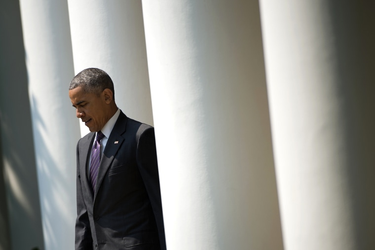 President Barack Obama arrives to speak in the Rose Garden of the White House in Washington, D.C. (Photo by Brendan Smialowski/AFP/Getty)