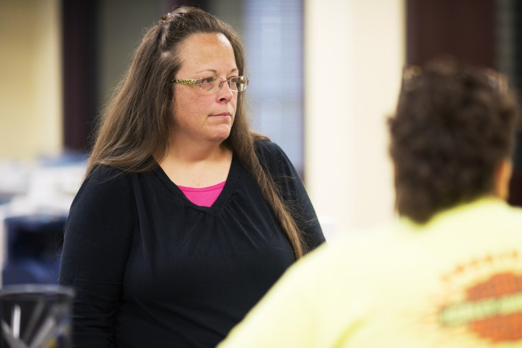 Kim Davis, the Rowan County Clerk of Courts, speaks to coworkers at the County Clerks Office on Sept. 2, 2015 in Morehead, Ky. (Photo by Ty Wright/Getty)