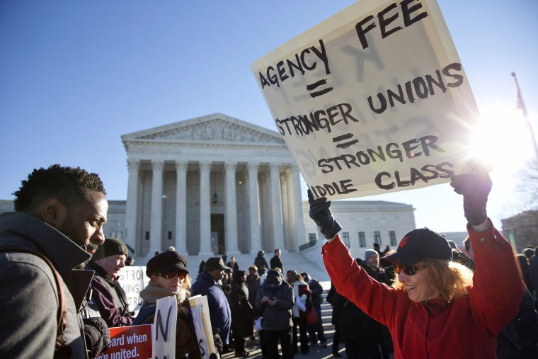 Protesters rally outside of the Supreme Court in Washington, Jan. 11, 2016, as the court heard arguments in the 'Friedrichs v. California Teachers Association' case. (Photo by Jacquelyn Martin/AP)