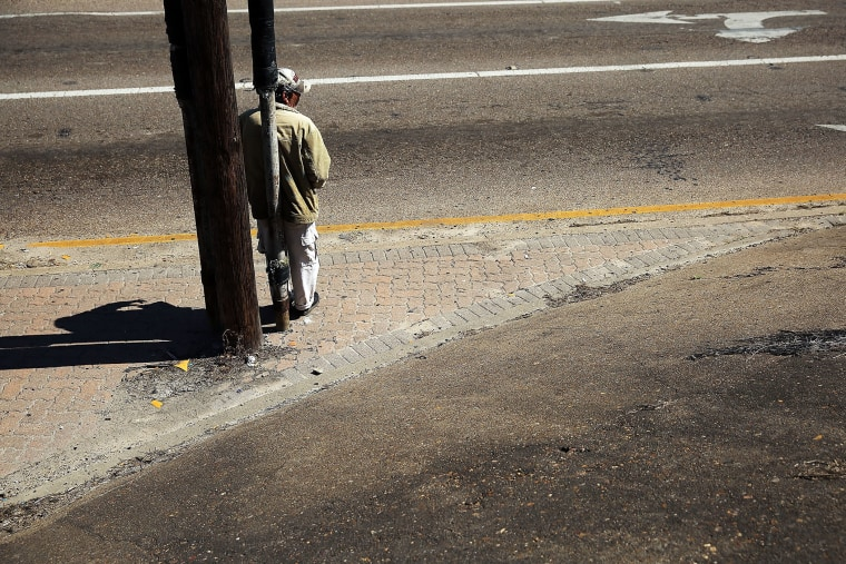 A homeless man looks for donations along a highway entrance on March 28, 2015 in Corpus Christi, Texas. (Photo by Spencer Platt/Getty)