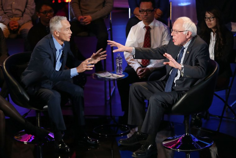 Democratic presidential candidate U.S. Sen. Bernie Sanders (I-VT) speaks with moderator Jorge Ramos during the the Iowa Brown and Black Forum on Jan. 11, 2016 in Des Moines, Iowa. (Photo by Joe Raedle/Getty)