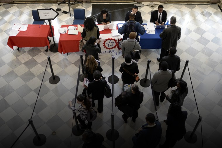 Job seekers wait to speak with employers at a job fair in Brooklyn, N.Y., on April 11, 2014. (Photo by Andrew Gombert/EPA)