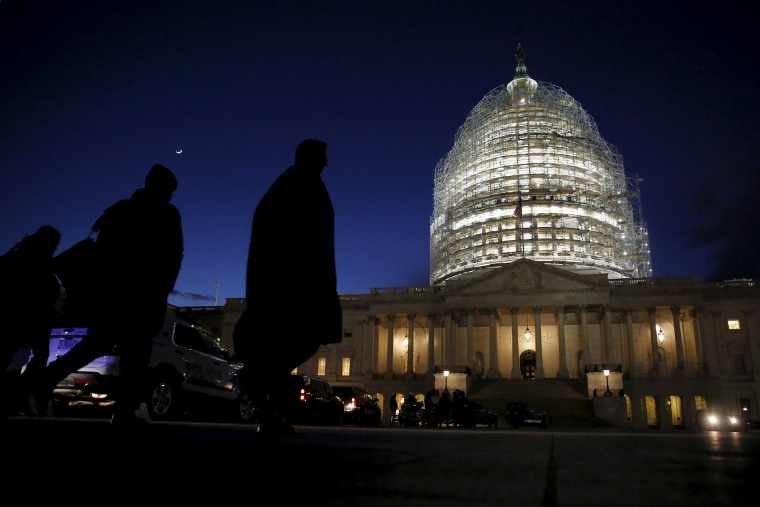 People walk past the U.S. Capitol dome in the hours before President Barack Obama delivers the State of the Union address to a joint session of Congress in Washington, Jan. 12, 2016. (Photo by Jonathan Ernst/Reuters)