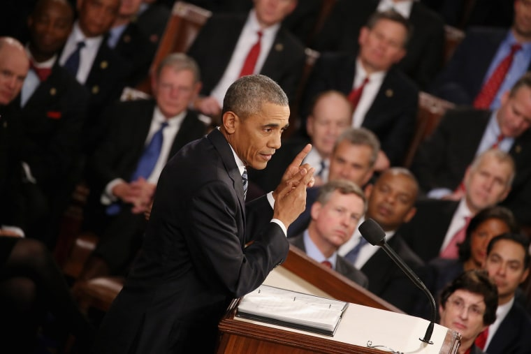 President Barack Obama gestures as he delivers the State of the Union speech before members of Congress in the House chamber of the U.S. Capitol Jan. 12, 2016 in Washington, DC. (Photo by Mark Wilson/Getty)