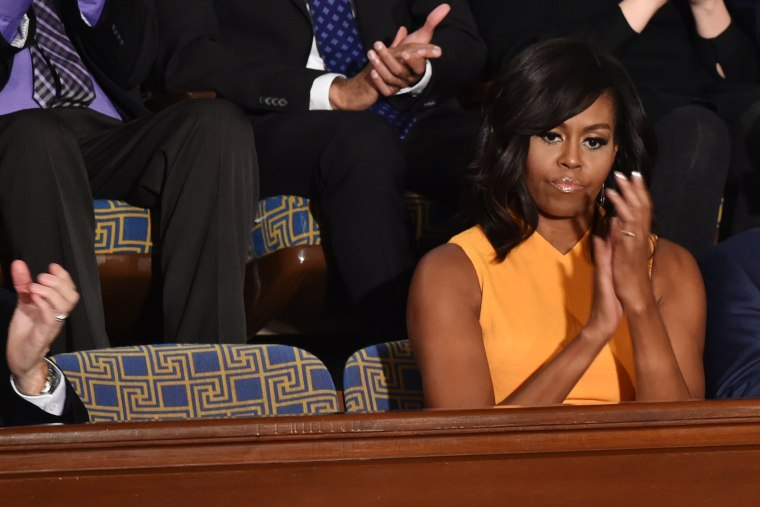 First Lady Michelle Obama sits next to a vacant seat to honor victims of gun violence during President Barack Obama's State of the Union on Capitol Hill in Washington, Jan. 12, 2016. (Photo by Nicholas Kamm/AFP/Getty)