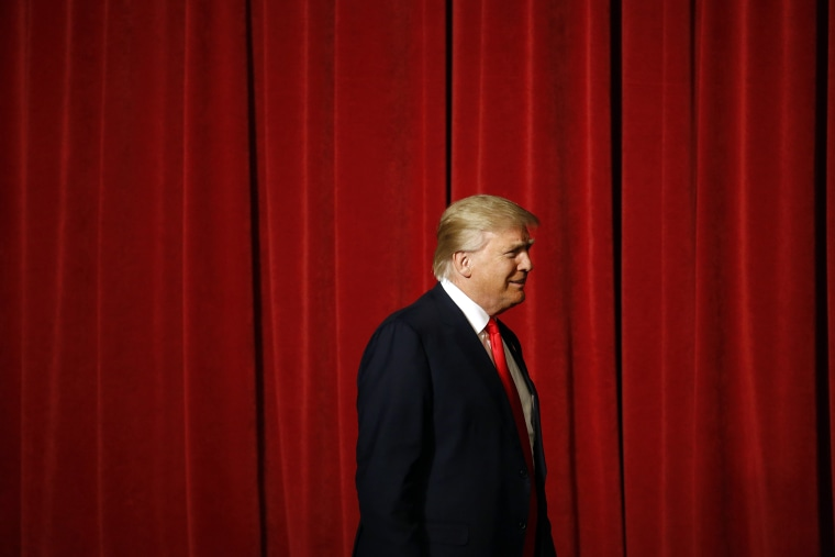 Republican presidential candidate Donald Trump walks onstage for a rally at the Surf Ballroom in Clear Lake, Iowa, Jan. 9, 2016. (Photo by Patrick Semansky/AP)