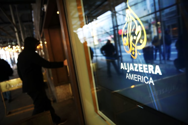 The logo for Al Jazeera America is displayed outside the cable news channel's offices on Jan. 13, 2016 in New York City. (Photo by Spencer Platt/Getty)