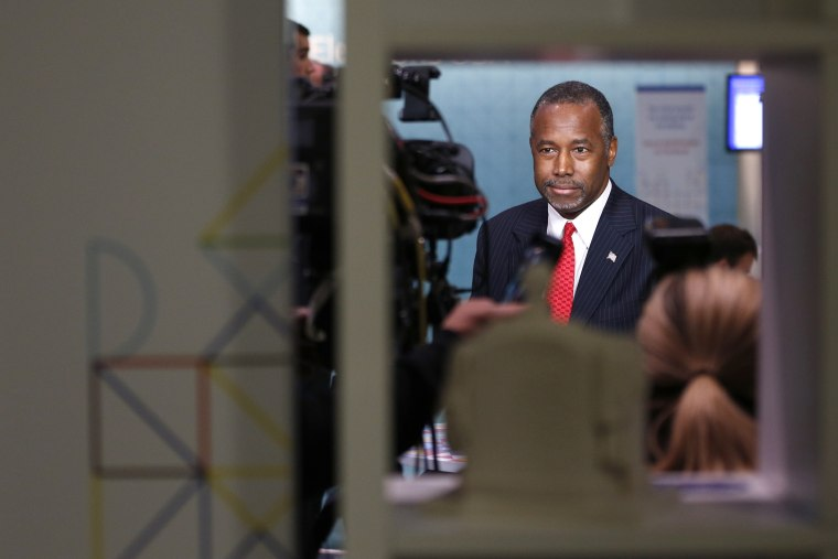 Republican presidential candidate Ben Carson prepares for a television interview in the press area before the CNN Republican presidential debate at the Venetian Hotel & Casino on Dec. 15, 2015, in Las Vegas, Nev. (Photo by John Locher/AP)