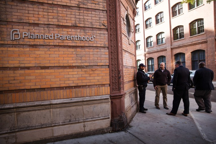 A police officer from the counterterrorism department stands guard outside Planned Parenthood on Nov. 30, 2015 in New York City. (Photo by Andrew Burton/Getty)