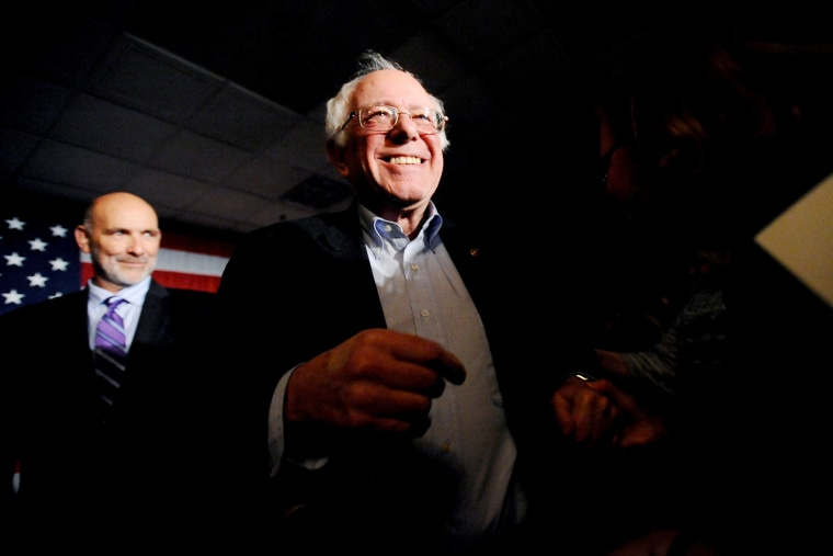 U.S. Democratic presidential candidate Bernie Sanders works the rope line at a New Year's Eve rally and party at the Renaissance Savery Hotel in Des Moines, Iowa Dec. 31, 2015. (Photo by Mark Kauzlarich/Reuters)