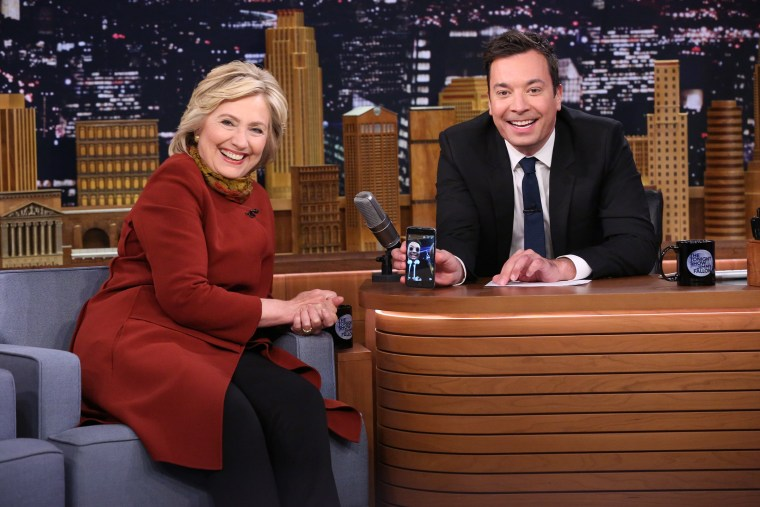 Presidential candidate Hillary Clinton shares a laugh with Jimmy Fallon as they take a Snapchat on Tonight Show, Jan. 14, 2016. (Photo by Douglas Gorenstein/NBC)