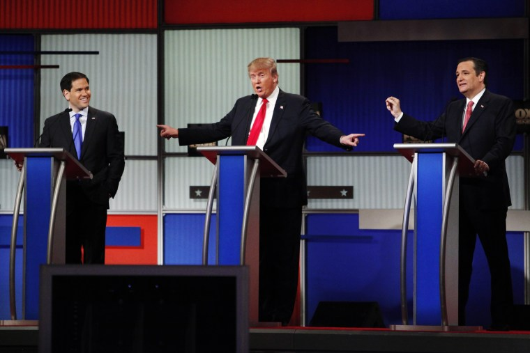 Presidential candidate Donald Trump gestures towards rivals Senator Marco Rubio and Senator Ted Cruz during the sixth Republican presidential candidates debate in North Charleston, S.C., Jan. 14, 2016. (Photo by Randall Hill/Reuters)