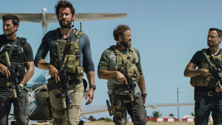 "Pablo Schreiber, John Krasinski, David Denman and Dominic Fumusa, in the film, ""13 Hours: The Secret Soldiers of Benghazi"" from Paramount Pictures and 3 Arts Entertainment/Bay Films. (Photo by Christian Black/Paramount Pictures/AP)"