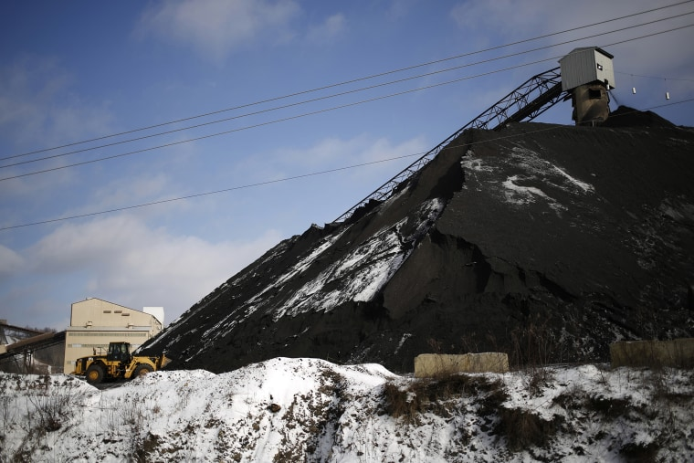 A Caterpillar Inc. front loader scoops coal from a mound at the Arch Coal Inc. Sentinel Prep Plant in Philippi, W.V., Jan. 13, 2016. (Photo by Luke Sharrett/Bloomberg/Getty)