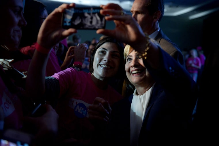 Democratic Presidential candidate Hillary Clinton takes a selfie with a supporter after receiving an endorsement from Planned Parenthood Action Fund, Jan. 10, 2016 in Hooksett, N.H. (Photo by Darren McCollester/Getty)