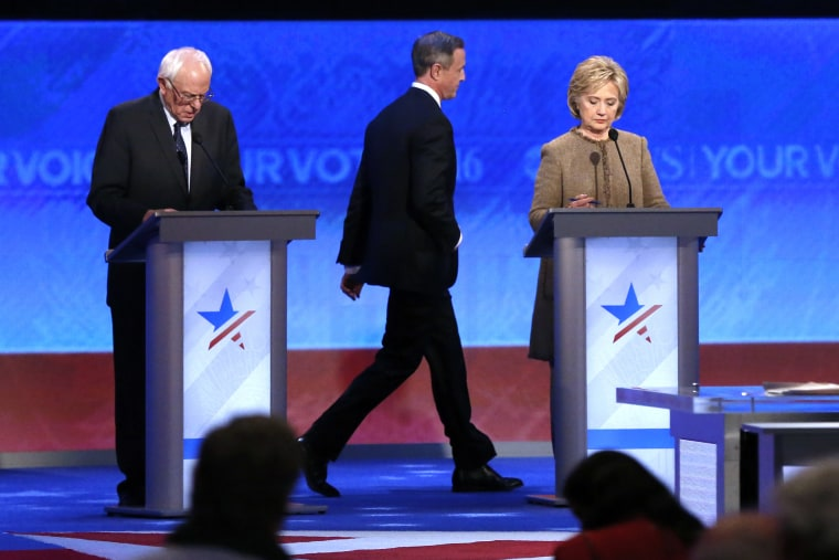 Martin O'Malley, center, returns to the stage past Bernie Sanders, left, and Hillary Clinton after a break during a Democratic presidential primary debate, Dec. 19, 2015, at Saint Anselm College in Manchester, N.H. (Photo by Jim Cole/AP)