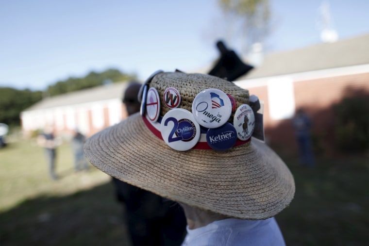 Undecided voter Mimi Dias of Charleston wears her Democratic hat before the start of a speech by U.S. Democratic presidential candidate Bernie Sanders at the annual Blue Jamboree in North Charleston, S.C., Nov. 21, 2015. (Photo by Randall Hill/Reuters)