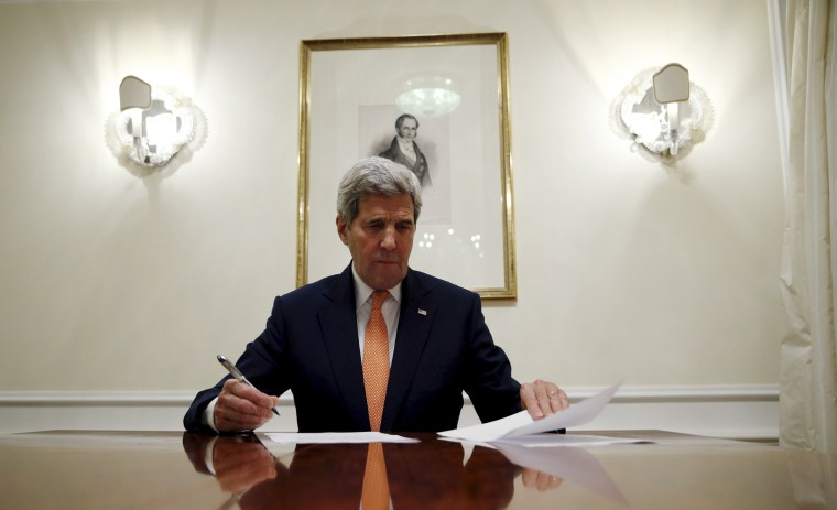 Secretary of State John Kerry signs the certification to the U.S. government that  IAEA certified Iran's compliance in their report, requesting the lifting of the nuclear-related sanctions, Vienna, Jan. 16, 2016. (Photo by Kevin Lamarque/Reuters)