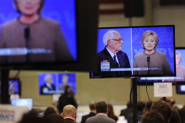 Democratic presidential candidates Hillary Clinton and Bernie Sanders appear on screens in the media room during the debate held at Saint Anselm College in Manchester, N.H., Dec. 19, 2015. (Photo by Gretchen Ertl/Reuters)